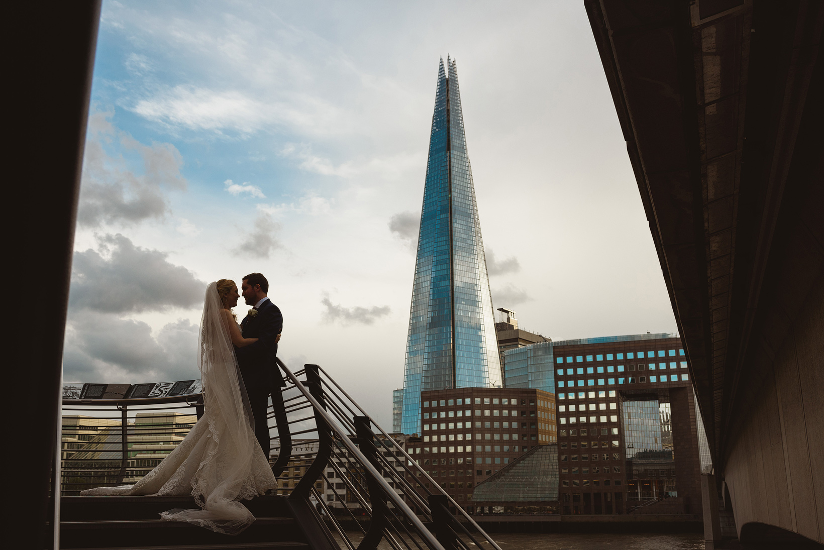 newlyweds in wide shot photograph with the Shard tower in the backdrop