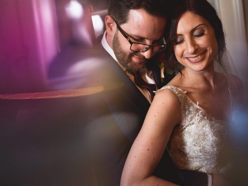 couple hug during jewish wedding ceremony